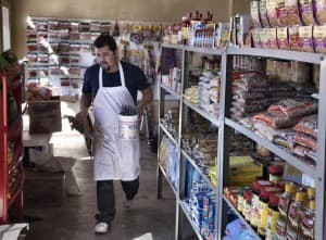 Marco Rosiles stocks the shelves at El Ranchito in Gillette, a store that caters to local Hispanics and others. (Adam Jahiel/WyoFile - click to enlarge)