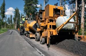 Contractors resurface section of road in Yellowstone National Park