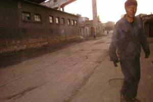Miner walking outside Jin Hua Gong Mine, Datong, Shanxi, China