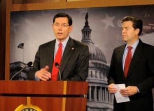 Sen. John Barrasso and Sen. Sam Brownback (R-Kan.)