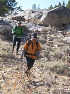 Robin Hopkins Guse, in orange, hikes with Shannon Kaminsky on Saturday near Lander