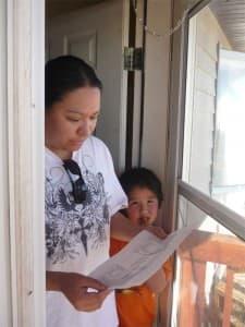 A Riverton resident examines a RezAction flyer