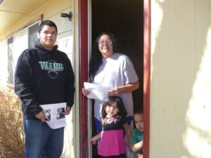 Inez Brown with one of the RezAction canvassers at her home in Riverton