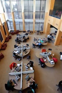 Students work at computer stations in the reconstructed Coe Library at the University of Wyoming