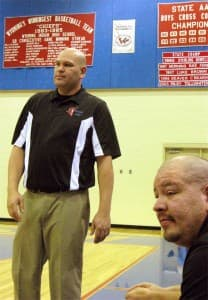 Coaching brothers Craig Ferris, left, and Michael Hiwalker, right, on the sidelines Friday night