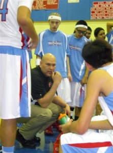 Coach Craig Ferris listens to his players during a time out.