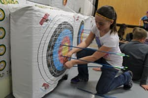 Gaby Wall, 10, tallies her score. Students at Wind River Elementary School are particpating a statewide virtual archery tournament. (Kelsey Dayton - Wyofile)