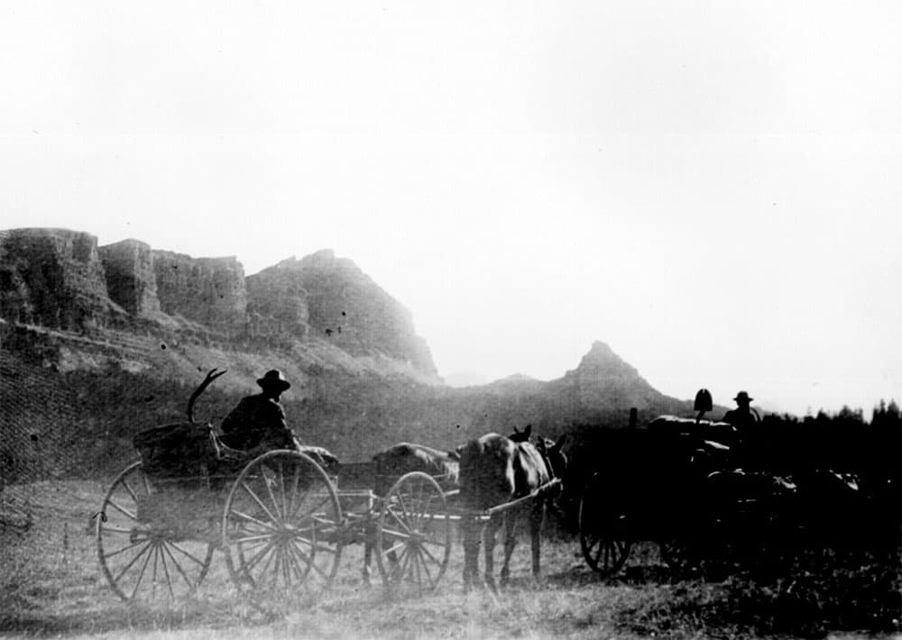 Construction workers haul equipment on military road towards Buffalo Fork, Wyoming in this 1898 photo.