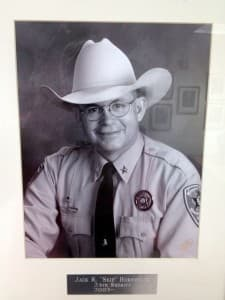 A photo of Fremont County sheriff Skip Hornecker hangs in the sheriff's office in Lander. Hornecker says his deputies' time and resources are drained by the time they spend enforcing driving laws on the reservation, which is within their jurisdiction to do so. (Ron Feemster/WyoFile — click to view)