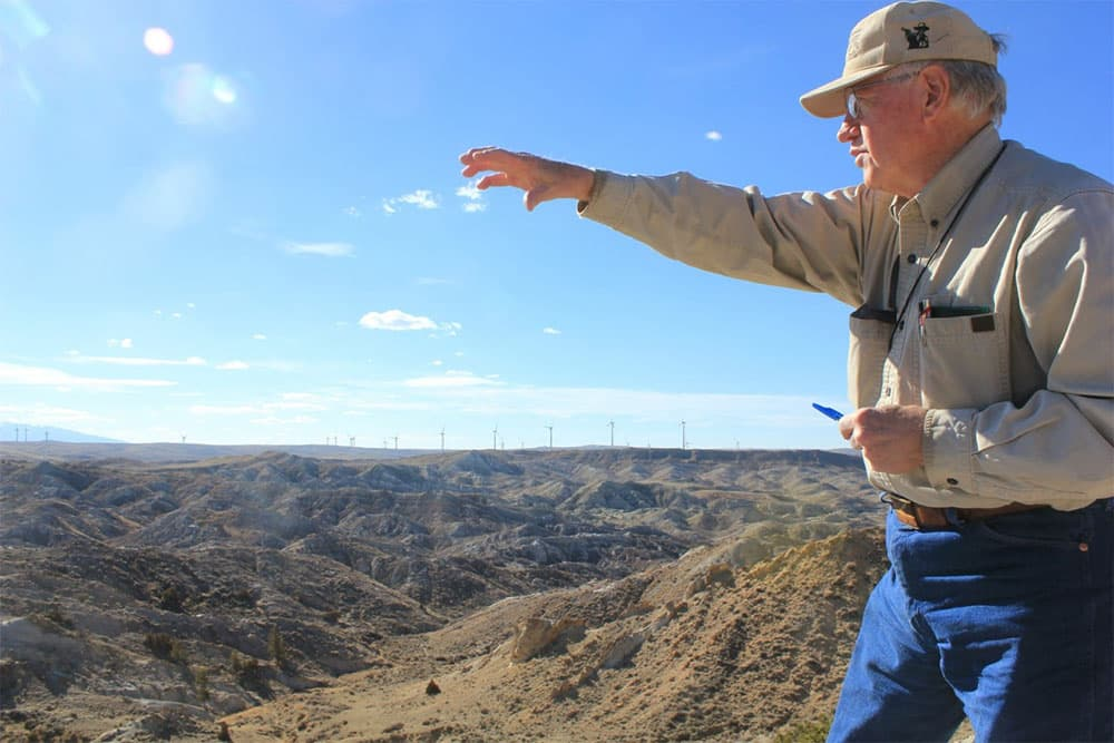 Jason Lillegraven looks out at Carbon Basin, the area he has studied ahead of the construction of DKRW Advanced Fuels' first proposed its Medicine Bow Fuel & Power coal-to-liquids complex. Lillegraven fears the project could have grave consequences, highlighting his concerns with his studies.
