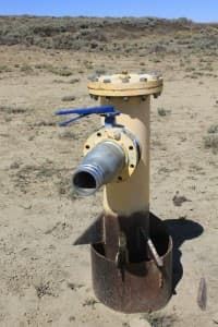 """Wyoming's State Engineer's Office has approved DKRW's water production plans in 2007 which require the installation of 12 production wells to obtain a total yield of 1,000 gallons per minute. In a concluding report, the state engineer determined """"sufficient water exists in the Mesaverde aquifer"""" to provide that water."""