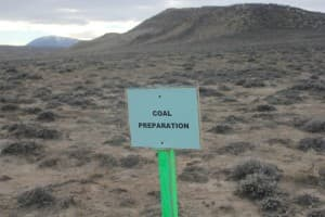 A sign posted on a Medicine Bow plain signals the upcoming coal preparation.
