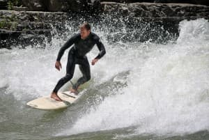 Brian Fox surfs on the Snake River Saturday. (Kelsey Dayton/Wyofile)