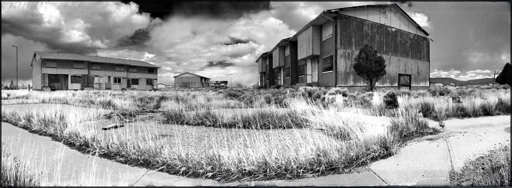 Abandoned apartment buildings in Jeffery City, Wyoming, which withered after the market for uranium busted. While Wyoming's economy is relatively stable today, the state faces several potential threats that could disrupt its revenue stream. (Morgan Tyree/Flickr — click to view)