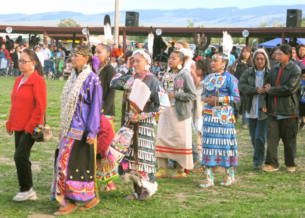 A group of cancer survivors and their family members join a procession June 21 to honor Natives who have battled cancer. At the Eastern Shoshone Indian Days, a powwow in Fort Washakie.