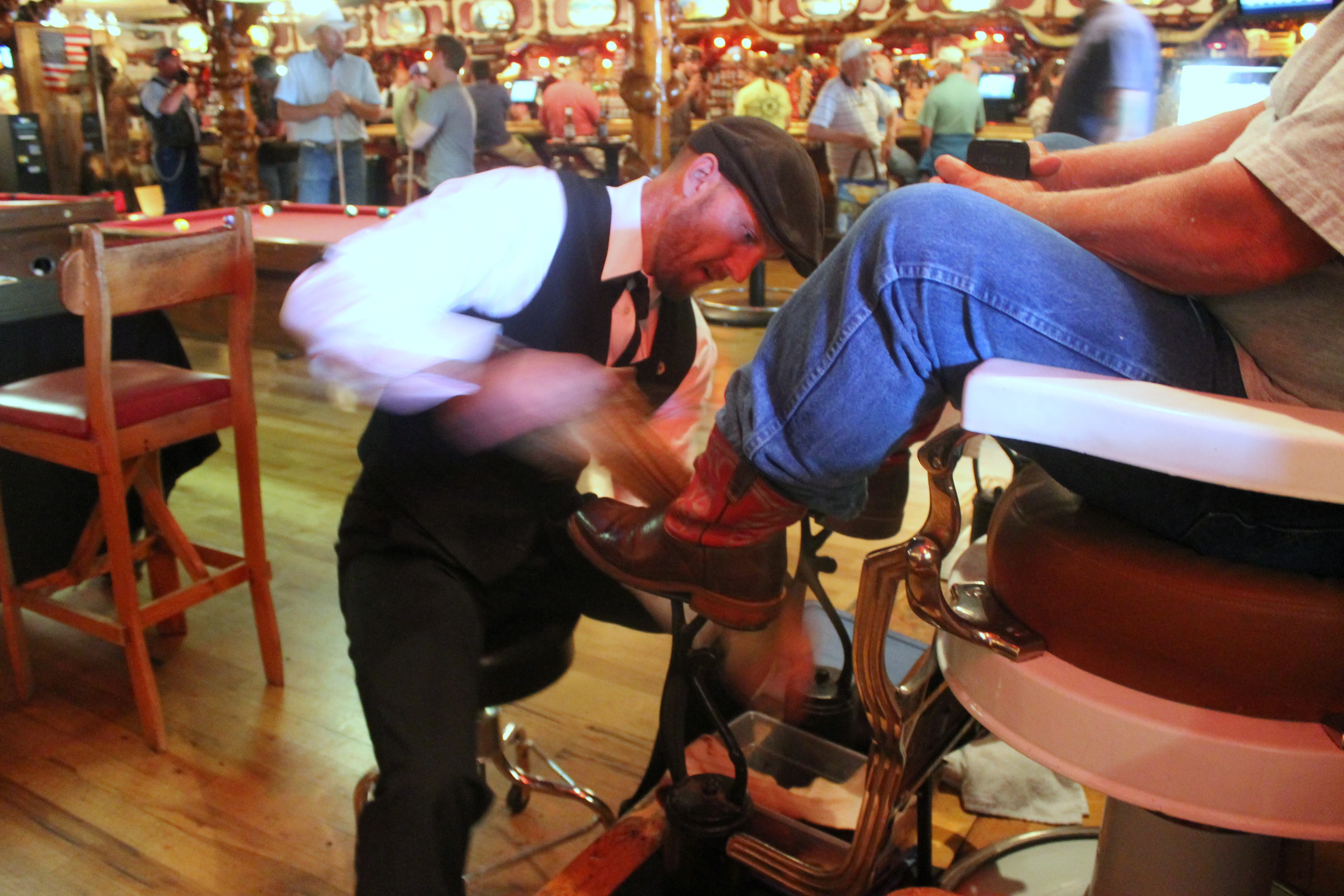 c18186ab5 Tim Tetley works on shining a pair of boots at the Cowboy Bar in Jackson.