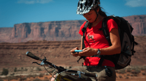 A mountain biker sends a few texts in Canyonlands National Park. (NPS Photo by Neal Herbert — click to enlarge)