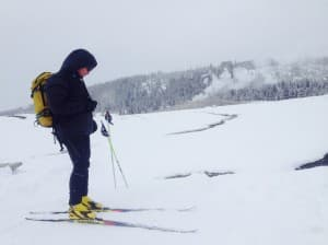 Derek Collins takes a break while skate skiing across Yelllowstone National Park. (Photo courtesy Forrest McCarthy – click to enlarge)