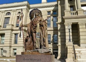 A statue of Chief Washakie stands in front of the Wyoming State Capitol.  (WyoFile/Gregory Nickerson — click to enlarge)