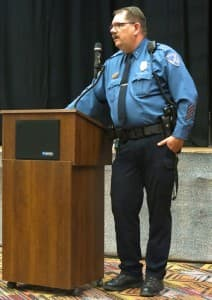 Lander Chief of Police Jim Carey stands at the podium. (WyoFile/Ron Feemster — click to enlarge)