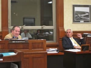 Rep. Steve Harshman (R-Casper) and  Sen. Eli Bebout (R-Riverton) debate budget amendments in a marathon conference committee session. (WyoFile/Gregory Nickerson — click to enlarge)