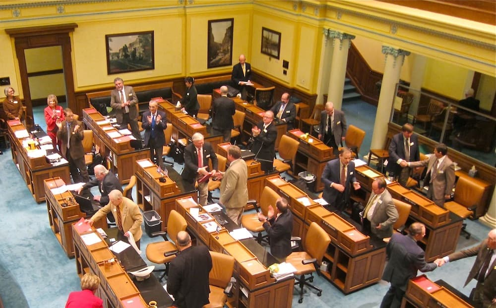 The Wyoming Senate applauds upon adjournment f the 2014 budget session. Lawmakers will likely return to Cheyenne in May for a special session to address legislation dealing with the role of the Superintendent of Public Instruction. On the Monday following adjournment, current Superintendent Cindy Hill attempted to move back into her office in the Wyoming Department of Education. The legislature removed her from direct oversight of the Department in the 2013 session. (WyoFile/Gregory Nickerson — click to enlarge)