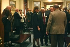 Superintendent of Public Instruction Cindy Hill speaks with legislators at the beginning of the session. (WyoFile/Gregory Nickerson — click to enlarge)