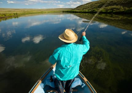"""A fly fisherman casts on the Green River above """"The Narrows"""" at Warren Bridge in Sublette County. (photo by Angus M. Thuermer, Jr.)"""
