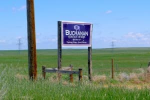 "A sign advertising Ed Buchanan's candidacy stands along a rural Wyoming Highway. Buchanan said raising $200,000 or more in the secretary of state race is ""not Wyoming style.""(WyoFile/Gregory Nickerson — click to enlarge)"