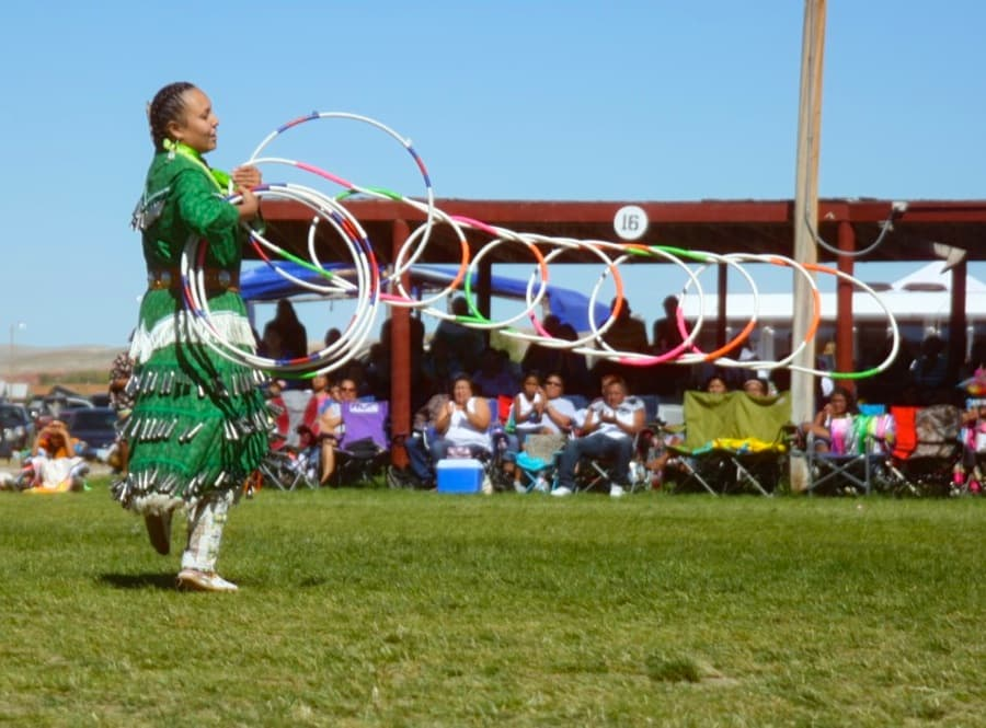 Hoop dancer Jasmine Bell (Crow Creek Sioux) of Riverton won second place in the Native Strut Hoop Dance Contest, sponsored by the Anne Abeyta family. (Gregory Nickerson /  WyoFile — click to enlarge)