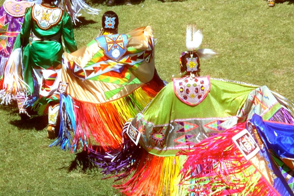 Ladies fancy dancers during the Sunday grand entry at the 2014 Eastern Shoshone Indian Days.(Gregory Nickerson /  WyoFile — click to enlarge)