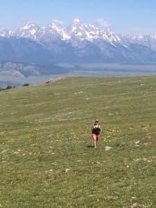 Cara Rank hikes Sheep Mountain. (Kelsey Dayton/WyoFile — click to enlarge)