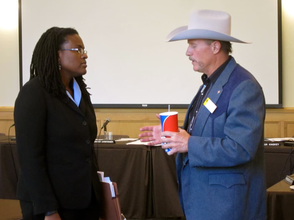 Sen. Larry Hicks (R-Baggs) compliments interim dean Jacquelyn Bridgeman on recent efforts at the University of Wyoming law school. The two spoke briefly following a meeting of the legislature's Judiciary Committee in Laramie on September 11, 2014. (Gregory Nickerson — click to enlarge)