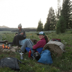 Eliza Landale (right) and Whitney Ball, both of Jackson, sit by a campfire while shadowing a ranger as part of the Young Ambassadors for Wilderness program. (Courtesy Wyoming Wilderness Association - click to enlarge)