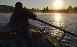 Sunrise over the Snake River with Joe at the oars. (Emilene Ostlind — click to enlarge)