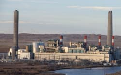 Utilities have added pollution controls to coal-fired power plants, including the Dave Johnston power plant near Glenrock. However, those upgrades do little to address carbon emission reduction goals as laid out in EPA's Clean Power Plan. (Dustin Bleizeffer/WyoFile)