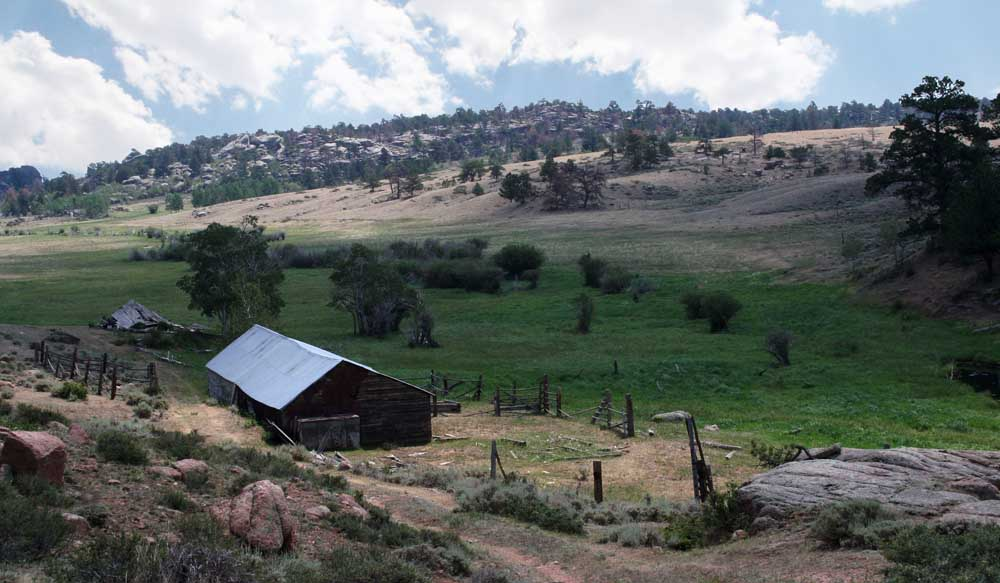 A homestead of the Y Cross ranch is situated near a hayfield. (Courtesy Donal O'Toole — click to enlarge)
