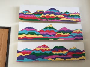 A triptych of colorful mountains painted by Joe McGowan hangs in his father's office at NOLS. (Courtesy photo — click to enlarge)