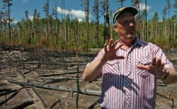 Roy Renkin, a vegetation specialist with the National Park Service, points out sections of a forest in Yellowstone National Park that were the subject of a prescribed burn in 2007 during a 2008 media tour looking back at the summer fires of 1988. (photo by Ruffin Prevost)