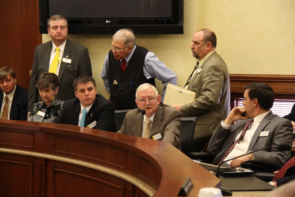 HB 114 sponsor Allen Jaggi (R-Lyman), at center, originally wrote the bill to repeal gun-free zones across Wyoming. Doing so would make schools safer and help prevent mass shootings, he said. (Gregory Nickerson/WyoFile)