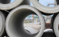 Concrete pipes are stacked at a manufacturing yard in Casper. (Dustin Bleizeffer/WyoFile)