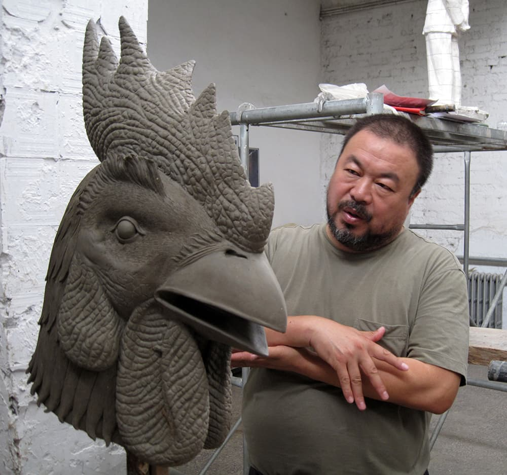 Artist Ai Weiwei with a rooster head he created for his Circle of Animals/Zodiac Heads exhibition.