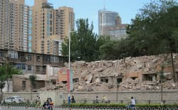Old buildings are torn down to make way for new construction in the city of Taiyuan, in the heart of China's coal-producing region. (Dustin Bleizeffer/WyoFile)