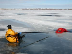 Members of Johnson County Search and Rescue practice ice rescues. The county has 16 members certified in ice rescue. (courtesy Johnson County Search and Rescue)