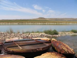 Most coal-bed methane wells bring up large volumes of water along with the methane.This 2006 photo shows a water-discharge facility on a Johnson County ranch near the Powder River. Dustin Bleizeffer/WyoFile)