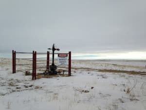 Coal-bed methane gas drilling concentrated mostly in Campbell, Johnson and Sheridan counties. Shown here in winter 2015 is a well just east of the Pumpkin Buttes in southern Campbell County. (Dustin Bleizeffer/WyoFile)