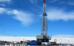 Drilling rigs, such as this one on a location north of Casper in 2014, require large surface operations. Some landowners say the state needs to update its oil and gas rules to ensure the operations do not encroach on residential areas. (Dustin Bleizeffer/WyoFile)