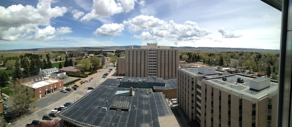 The view east from the 12 stories up in White Hall, the highest building in Wyoming. McIntyre Hall is at center, with Washakie Dining Center below, and Downey Hall to the right. If the new plan were carried out, residence halls would be no more than six stories high. (Gregory Nickerson/WyoFile)