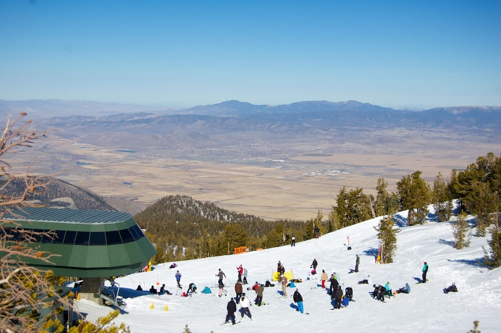 The stark contrast between Nevada desert and man-made California snow is obvious from the top of Heavenly Mountain Resort in South Lake Tahoe, Calif. (Kendall Brunette)