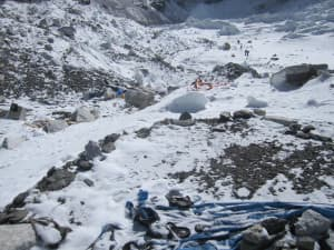All that is left of a tent that sat at base camp on Mount Everest are a pair of sandals. (courtesy Darren Rogers)